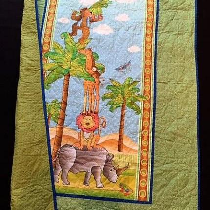 African Animal quilt with green border