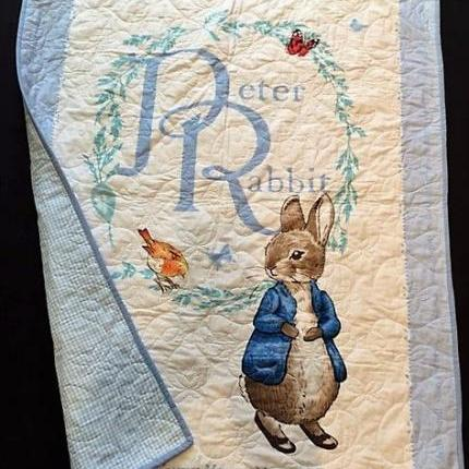 A Peter Rabbit Blue or Pink quilt